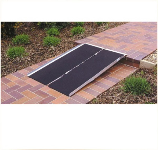 Portable ramp on sidewalk step